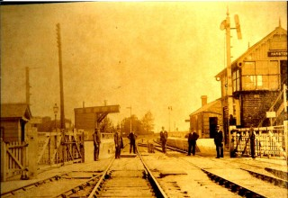 Early 1900s. Harston station and level crossing with signal box on right, station house on right. Note full width gates. | (Deacon)