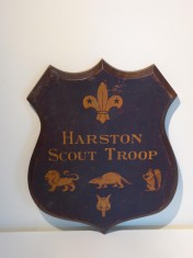 Scouts shield showing 1935 patrols Lion, Beaver, Squirrell, Fox