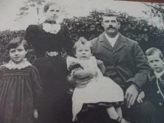 George and Elizabeth Farrington with Ida Frederick and Bernard sitting on George's lap. | (W Farrington)