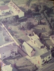 Aerial view of No 49 High St and large garden behind.