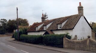 1990s Dormer cottage with 3 dormers and catslide roof sloping to back | (M Cash)
