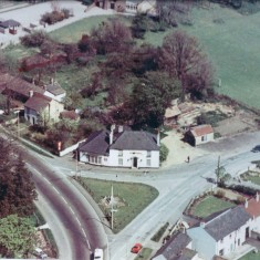 Date unknown. aerial view of No 2 Pemberton Arms facing War Memorial Green in centre, High St to left, Station Rd to right. | (Deacon)