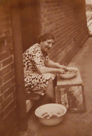 Elizabeth May Payne shelling peas back door 5 Manor Close 1951 | (P Froom)