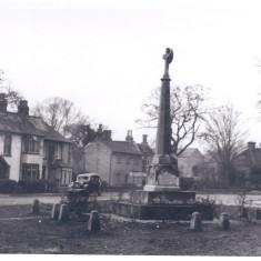 War Memorial NB bottom left metal railing & lamp surrounding pump 1982 | (Deacon)