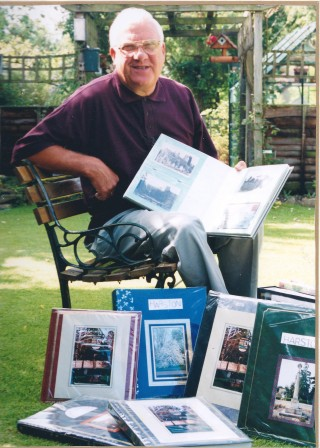 David in 1999 showing his history albums for Cambridge Evening news