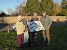 Irene Deacon (supplied photos), John Roadley (researcher), Nigel Schoepp, Peter Griffin (volunteer sign installers) beside the new Interpretation Board on The Green, Nov 2016