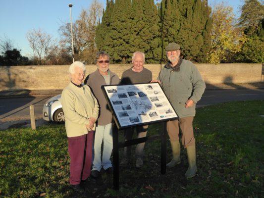 Irene Deacon (supplied photos), John Roadley (researcher), Nigel Schoepp, Peter Griffin (volunteer sign installers) beside the new Interpretation Board on The Green, Nov 2016