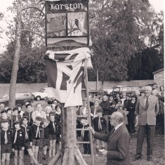Unveiling village sign by Mr Barker, Col Hurrell on right | (Deacon)