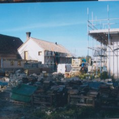 Date unknown. Home Farm outbuildings being renovated. Coach House in left background. | (Deacon)