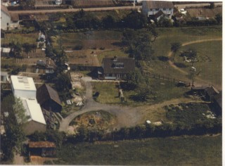 Post 1960s aerial view of Manor House farm & Dora Radford's house. | (Deacon)