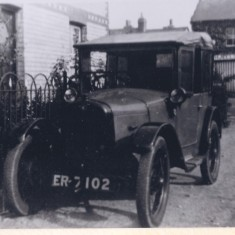 Early car outside No 28 High St, H J Ellis the butchers | (Deacon)