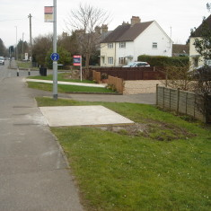 Bus Stop A10 verge No 118 High Street east Feb 2016. New concrete base. | (Griffin)