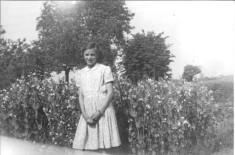 Maureen Ellwood (nee Northrop) by veg garden on right of path to Fleece Cottage