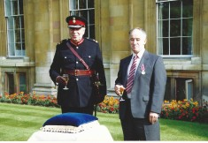 Brian Arbon receiving long service medal at Clare college 1992 from James Crowden, Lord Lieutenant
