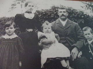 George and Elizabeth Farrington with Ida Frederick and Bernard sitting on George's lap. | (W Farrington)