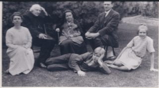 Canon Balwin & family in Vicarage grounds | (Deacon)