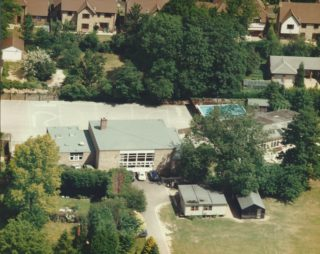 Aerial view of Harston School hall, & pool by infant block | (Harston School)