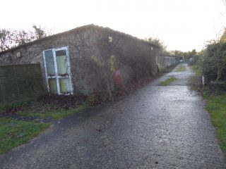 Gatward's old office once Nutcombes with piggeries behind 2019   (Roadley)