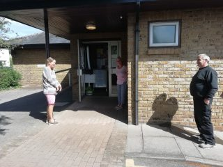 social distancing queuing at Harston Surgery for dispensary during Covid19 May 2020 | (Roadley)