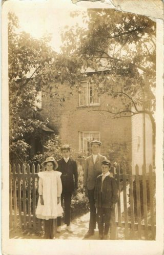 1911 postcard showing Newling family Grace, Arthur, Robert & William in front of 31 Church St | (Roadley)