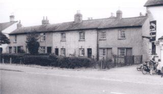 Original terrace: Nos 40 - 52 High St next to PO probably 1940s | (Deacon)
