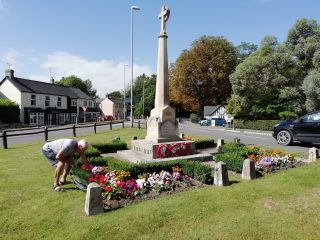 Scoutmaster Roger Summerfield tending the Harston War memorial 20 Aug 2020 | (Roadley)