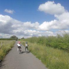 Cycling through Trumpington Meadows Country Park | (K Davenport)