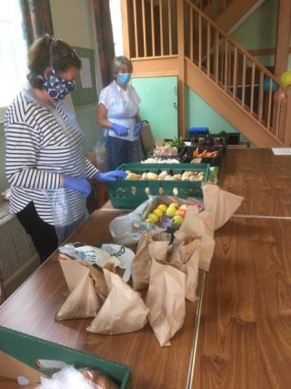 Kathy helping in background at Food Hub | ( K Holloway)