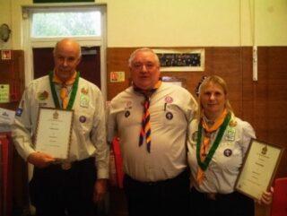 Colin Free left, Brenda right receiving medals of Merit 2016