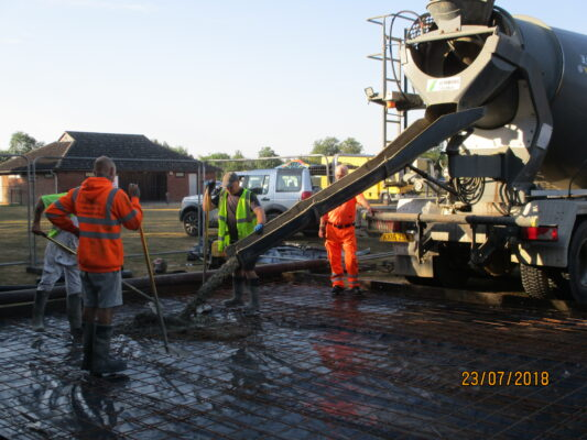 Preparing base of scout hut on Harston Rec Jul 2018
